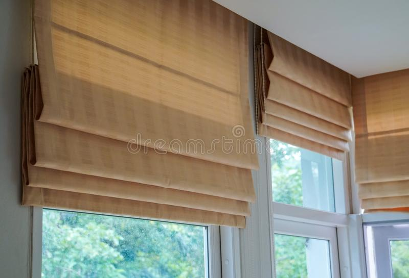 Brown roman blind shade curtain tree forest mountain background living room. Brown roman blind shade curtain tree forest mountain background, living room royalty free stock photos