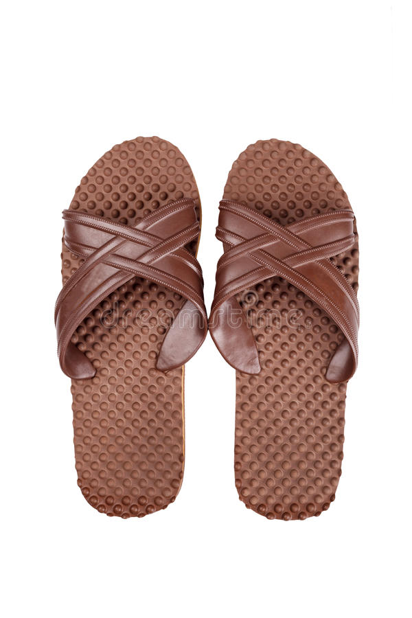 Brown rubber flip flops on a white background royalty free stock images