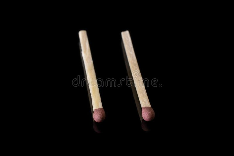 Brown safety match isolated on black glass stock photos