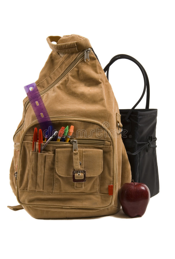 Brown School Back Pack full of school supplies and an apple royalty free stock photos