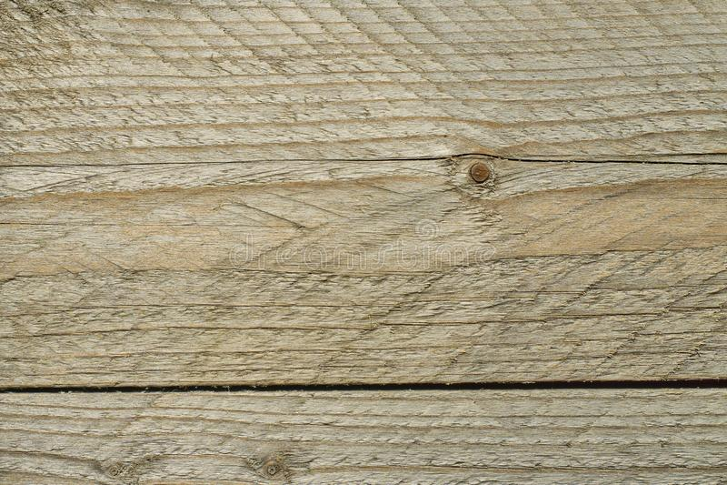 Brown scratched wooden board. The surface of the old  wood texture,top view royalty free stock photo
