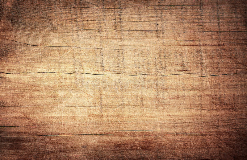 Brown scratched wooden cutting board. Wood texture stock photo