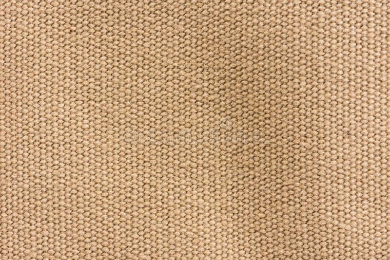 Brown-Segeltuchbeschaffenheitshintergrund lizenzfreie stockbilder