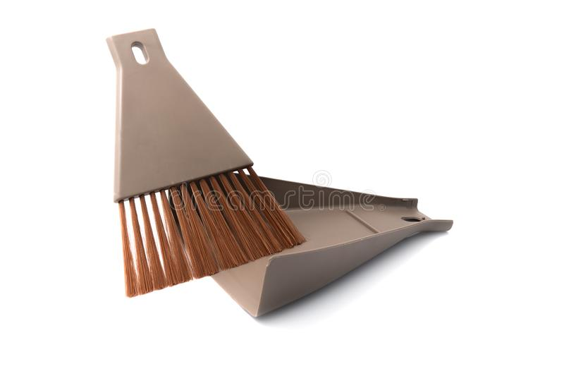 Brown set of brush and dustpan, household cleaning utensil with isolated stock photography