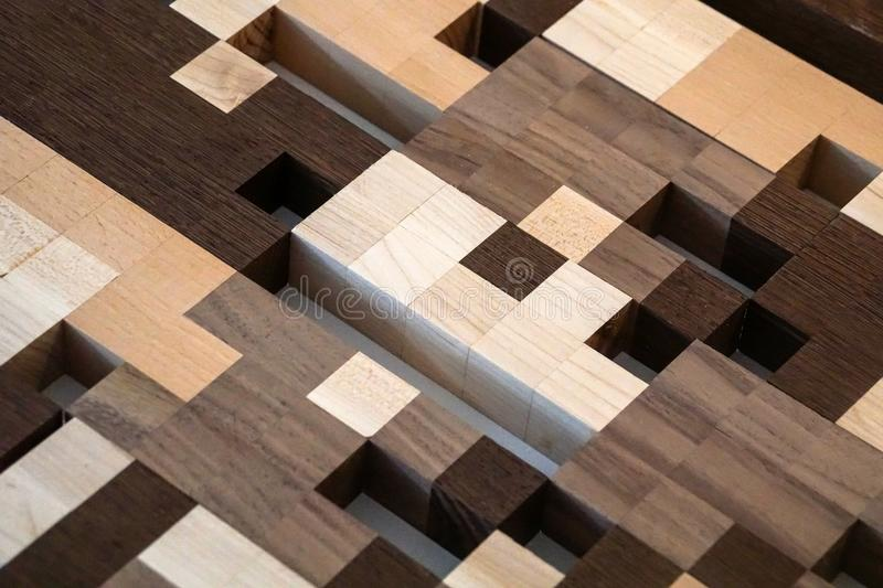 Brown shade wooden jigsaw puzzle background pattern royalty free stock image