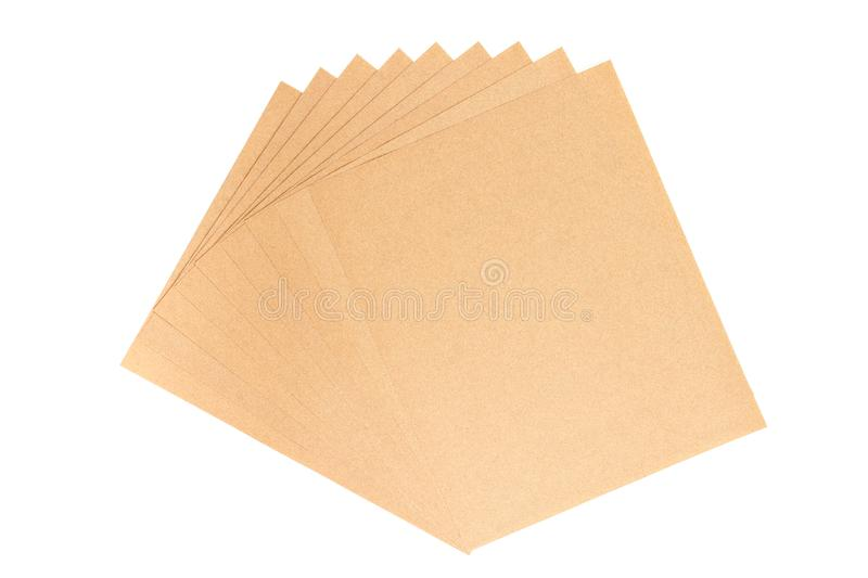 Brown sheet sandpaper. Brown sheet sandpaper for wood work stacked isolated on white background stock image