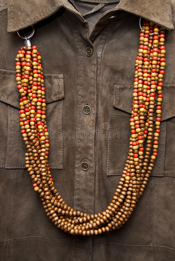 Brown shirt with color necklace stock images