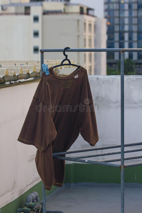 Brown shirt hanging outdoor clothes royalty free stock photos