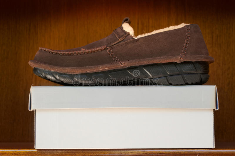 Brown shoes on box royalty free stock photos