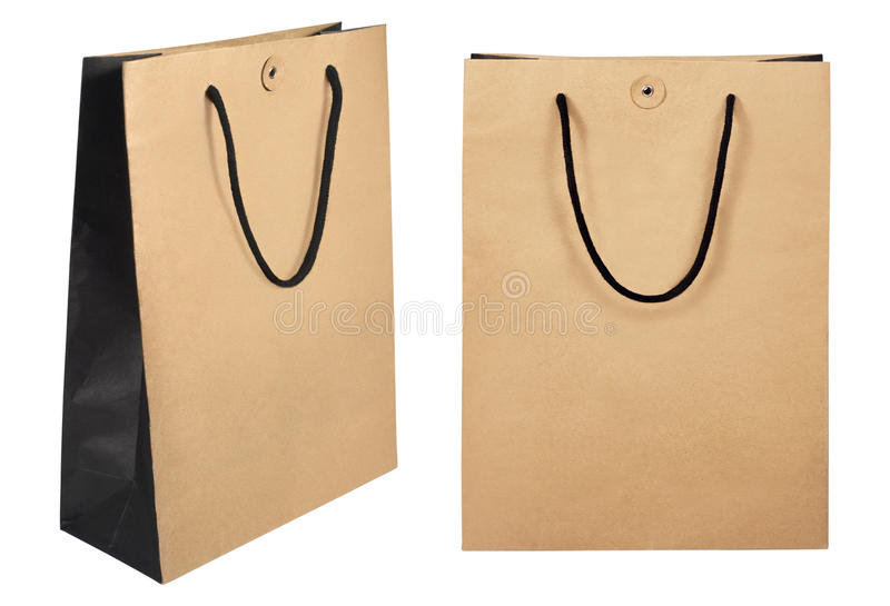 Brown shopping paper bags isolated on white background with clipping path. Photo take on 2016 stock image