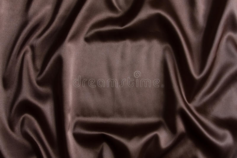 Brown-silk Textilhintergrund stockfotografie