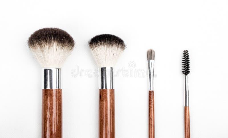 Brown and Silver Makeup Brush Set royalty free stock photos