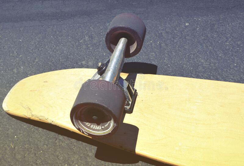 Brown Skateboard on Concrete Road royalty free stock image
