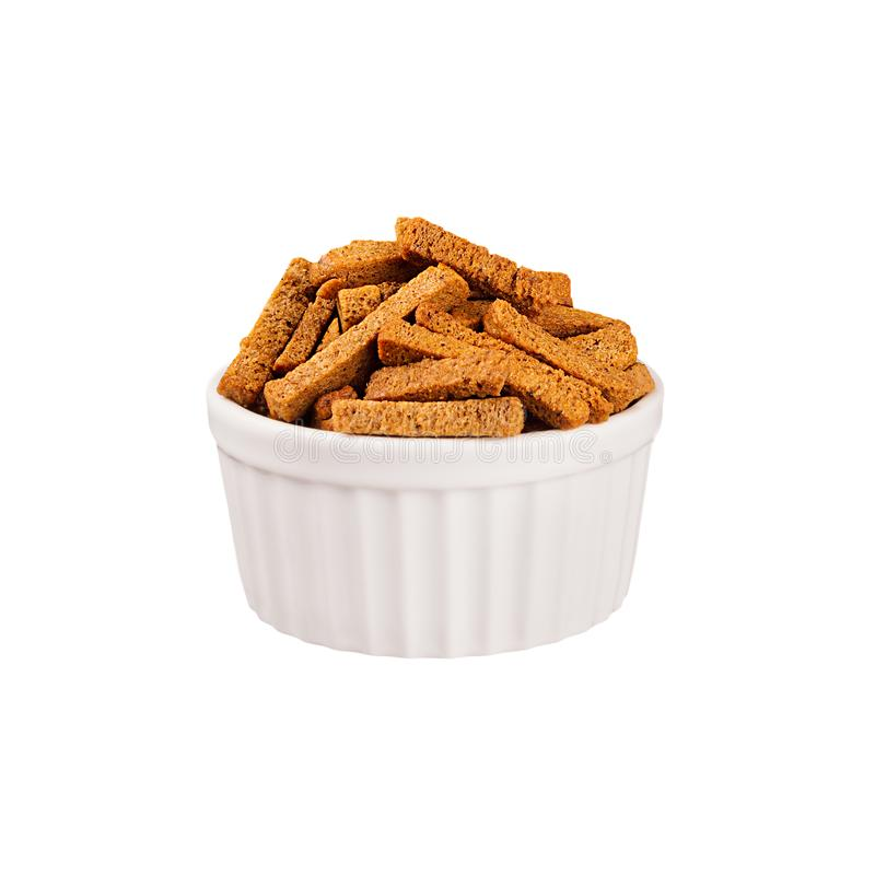 Brown sliced rye bread sticks as croutons in white ceramics bowl isolated on white background. Fast food template for menu, advertising, cover stock photos