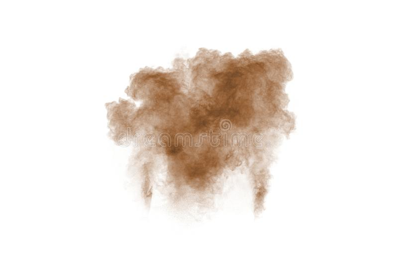 Brown smoke on white background. Brown dust particle exhale in the air.  royalty free stock photography