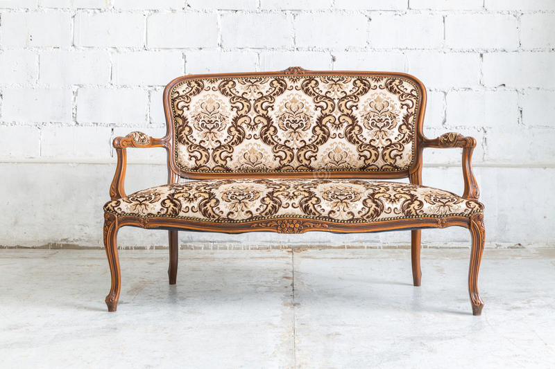 Brown sofa couch. Brown Classical style sofa couch in vintage room stock photo