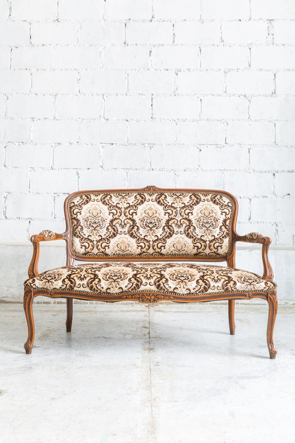 Brown sofa couch. Brown Classical style sofa couch in vintage room royalty free stock photo