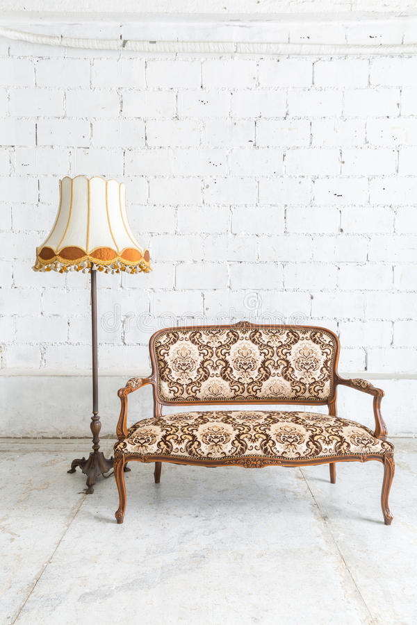 Brown sofa couch lamp. Brown Classical style sofa couch in vintage room with desk lamp royalty free stock photo