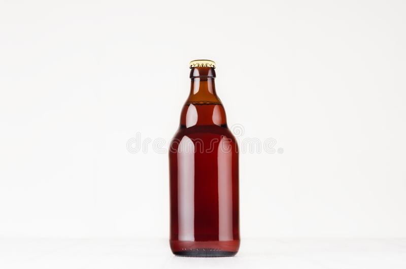 Brown steinie belgian beer bottle 330ml mock up. Template for advertising, design, branding identity on white wood table. Brown steinie belgian beer bottle stock images