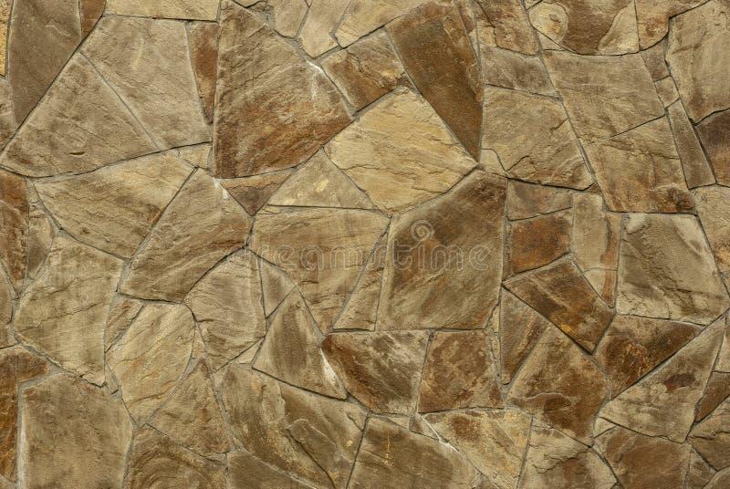Brown-Steinwand-Hintergrundbeschaffenheit lizenzfreies stockbild