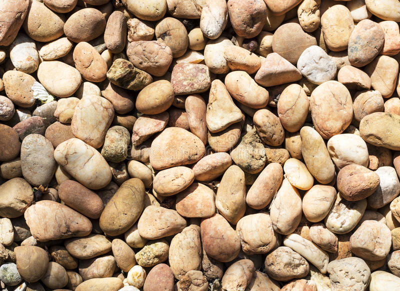 Brown stone, gravel, texture background. Brown stone, gravel, concept for texture and background stock photo