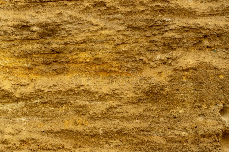 Brown stone texture background, limestone, wall texture, Old brown stone wall. Abstract background of brown stone wall. Brown stone texture background, limestone royalty free stock photography