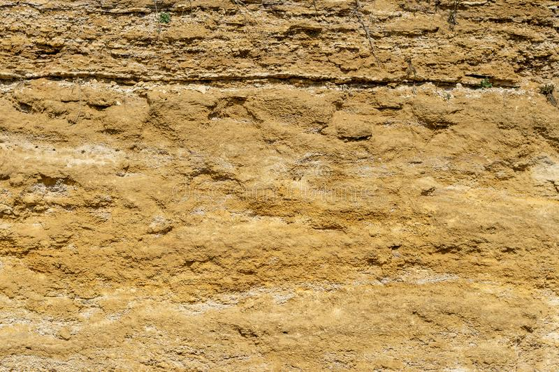 Brown stone texture background, limestone, wall texture, Old brown gold stone wall, stone wall, abstract view, exterior. Abstract background of brown stone royalty free stock photography