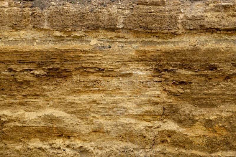 Brown stone texture background, limestone, wall texture, Old brown gold stone wall, stone wall, abstract view, exterior.  royalty free stock photo