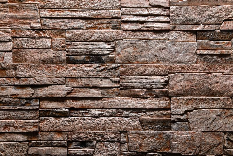 Brown Stone wall texture background natural color royalty free stock photos