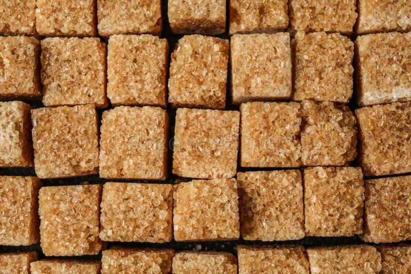 Brown sugar, closeup stock images