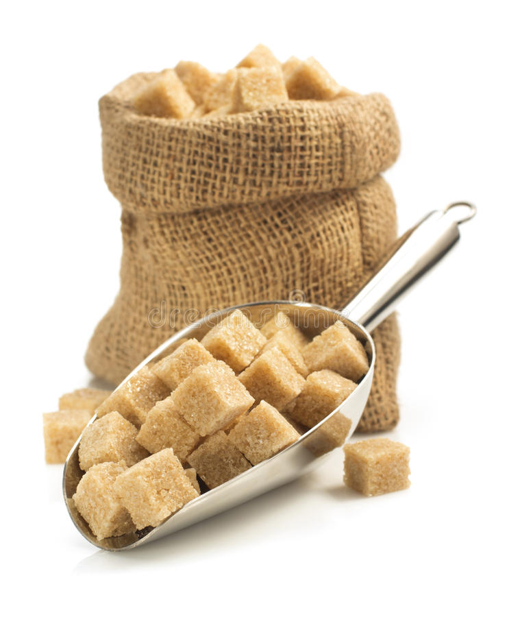Brown sugar cubes in scoop on white royalty free stock photos