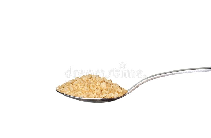 Brown sugar on metallic teaspoon. Isolated on white background royalty free stock image