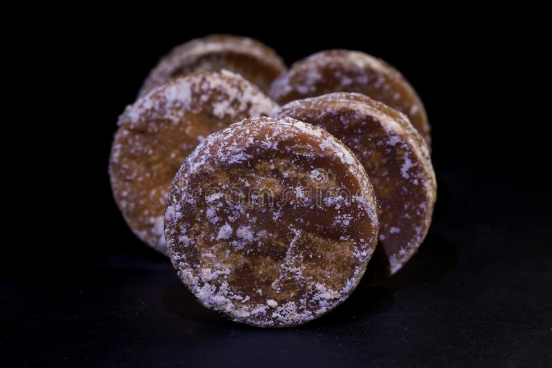 Brown sugar and palm sugar. Isolate on black background stock image
