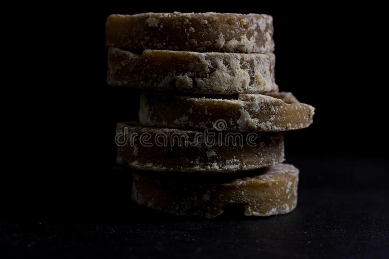Brown sugar and palm sugar. Isolate on black background royalty free stock image
