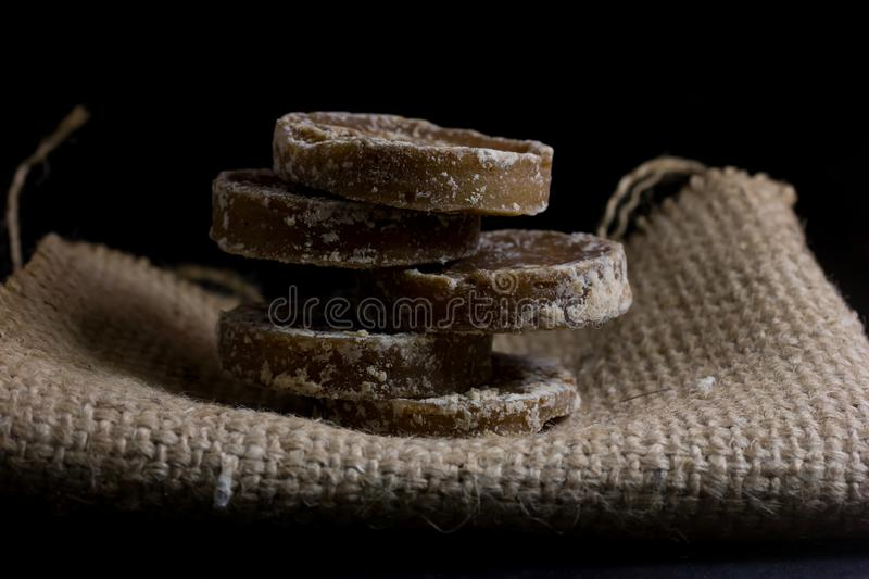 Brown sugar and palm sugar. Isolate on black background stock photography