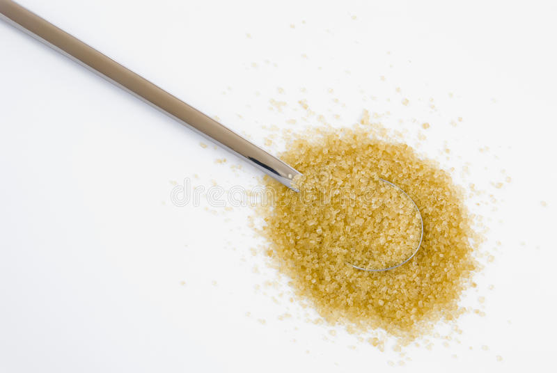 Brown sugar on silver teaspoon
