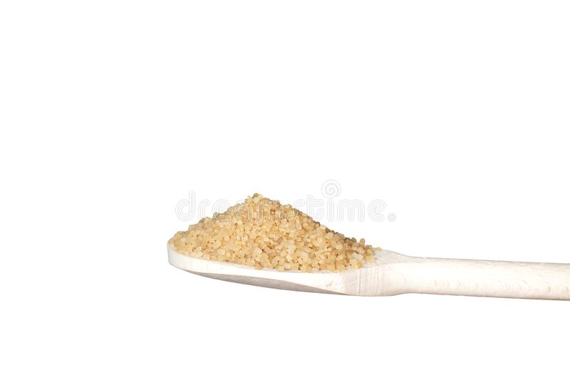 Brown sugar on wooden teaspoon. Isolated on white background stock photos