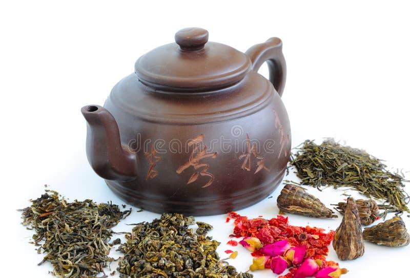 Brown teapot and loose tea royalty free stock photo