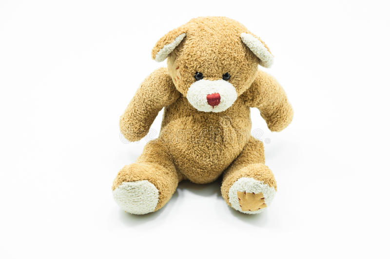 Brown Teddy Bear toy sitting on White. Background royalty free stock photography