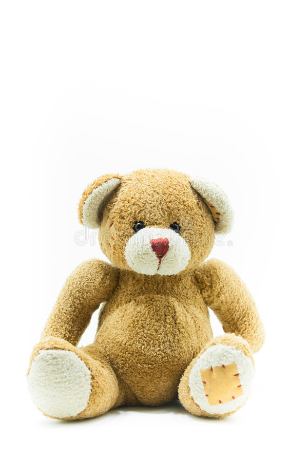 Brown Teddy Bear toy sitting on White. Background royalty free stock photo