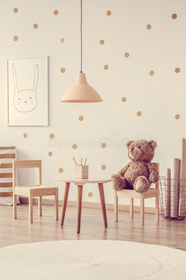 Brown Bear On Wooden Chair Next To Small Table In Scandinavian Kid S Playroom With Wooden Furniture Stock Photo Image Of Apartment Elegant 181324016