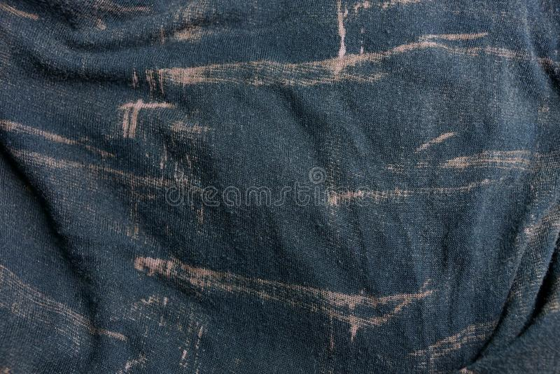 Brown texture of speckled crumpled fabric on old clothes. Brown background of speckled crumpled fabric on old clothes stock photography