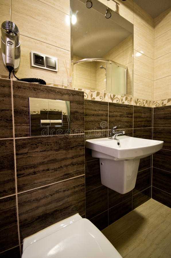 Brown theme bathroom royalty free stock images