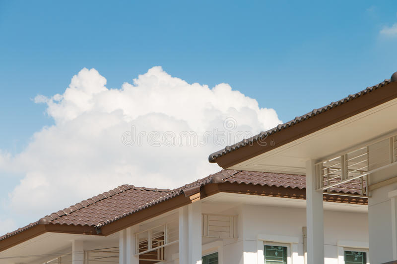 Brown tile roof on a new house stock image