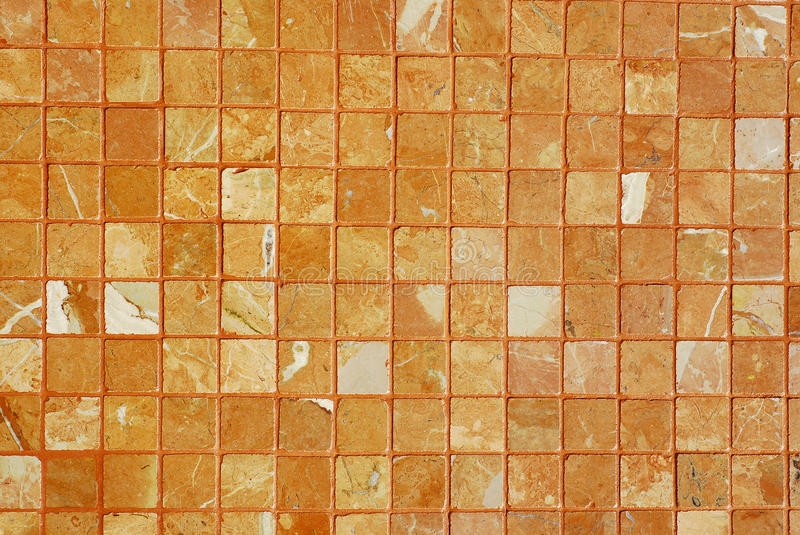 Brown tiles wall texture royalty free stock photo