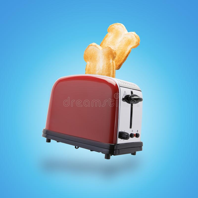 Brown toast jumping out of toaster. Brown toast jumping out if red and stainless steel toaster on a blue background royalty free stock image