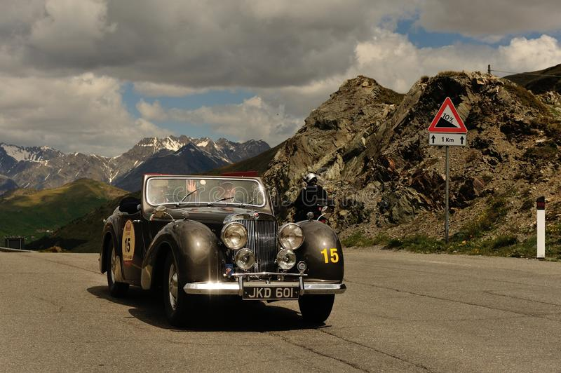 A brown Triumph Roadster 1800. LIVIGNO, ITALY - JUNE 13: A brown Triumph Roadster 1800 takes part to the Summer Marathon classic car race on June 13, 2014 in royalty free stock image