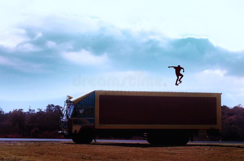 Brown Truck With Man With Skateboard on Top royalty free stock image