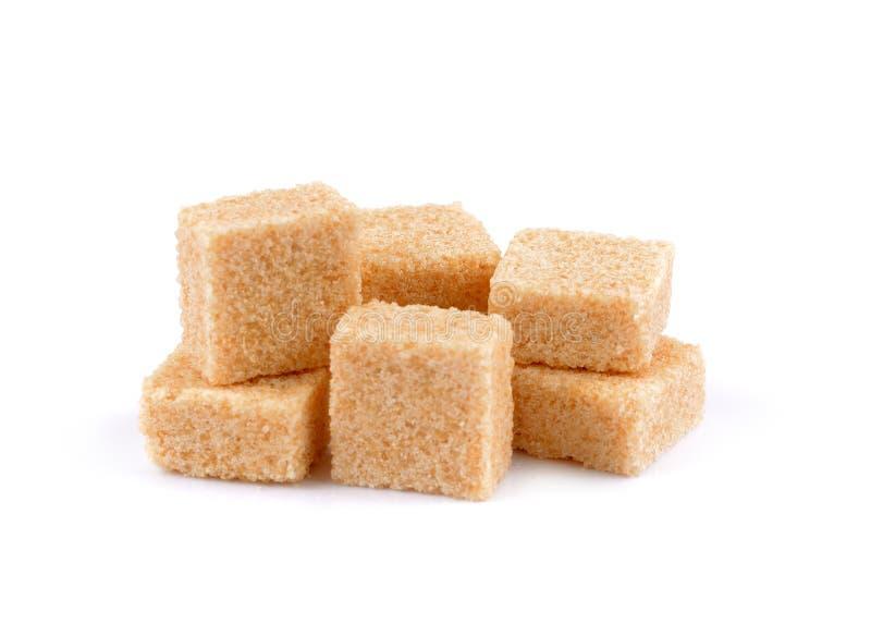 Brown trzciny cukieru sześciany, Brown trzciny cukieru sześciany odizolowywający zdjęcia stock