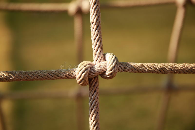 Brown Twisted Rope of climbing net in the playground. Rope knot royalty free stock photos